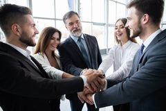 Success and winning concept - happy business team celebrating victory in office. Success and winning concept - happy business team celebrating victory in office royalty free stock photos