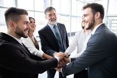 Success and winning concept - happy business team celebrating victory in office. Success and winning concept - happy business team celebrating victory in office royalty free stock photography