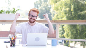 Success, Winning Deal, Excited Man Sitting in Outdoor Office, Red Hairs Royalty Free Stock Images