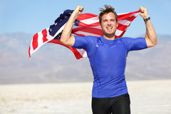 Success - winning runner cheering with USA flag. Celebrating victory. Fit American male winner fitness running model in celebration of success win. Face Stock Photography