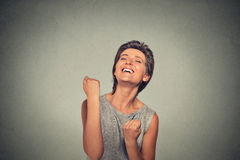 Success. Woman exults pumping fists ecstatic celebrates success Stock Photography