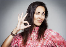 Success woman showing hand ok sign. Success pretty woman showing hand ok sign Royalty Free Stock Images