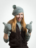Success woman thumbs up. The girl with European appearance on a light background Stock Photography