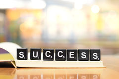 Success word from black plastic blocks on notebook with vintage filter Royalty Free Stock Image