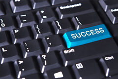 Success word on the blue button. Image of blue button with success word on the computer keyboard Royalty Free Stock Photos