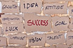 Success word cloud made on cardboard. Cutouts stock images