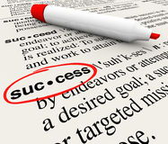 Success Word Definition Circled in Dictionary. The word Success and its definition circled in a dictionary, defined to convey the meaning of a successful mission Stock Photos