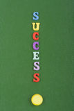 SUCCESS word on green background composed from colorful abc alphabet block wooden letters, copy space for ad text royalty free stock photo