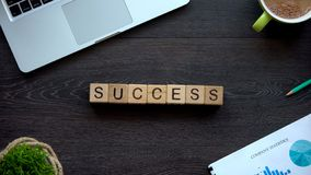 Success word made of cubes on table, goals achievement and career growth. Stock photo stock photos
