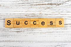 Success word made with wooden blocks concept.  Stock Photo
