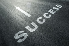 Success word message on the asphalt floor Stock Images
