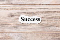Success of the word on paper. concept. Words of Success on a wooden background.  Royalty Free Stock Photos