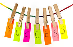 SUCCESS word on rop. SUCCESS word on wooden clothespin hanging on rope Royalty Free Stock Image
