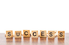 Success word wood on table. Success word wood on table, Isolated on white background with copy space. Save clipping path Stock Image