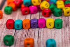 Success Word In Wooden Cube. Close up Stock Photos
