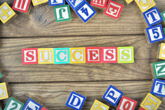Success word. On wooden table Stock Images