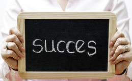 Success word written on blackboard/chalckboard Stock Photography