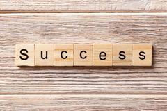 Success word written on wood block. Success text on table, concept.  Stock Photography