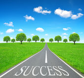 Success writen on emty road. Stock Images