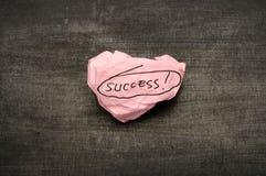 Success writing on crumpled paper Stock Photos