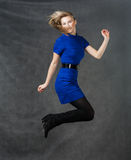 Success - young active businesswomen jumping in Stock Images