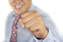 Success. Young businessman smiling and showing his clenched hand to fist Stock Image