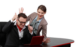 Success. Young happy couple getting good new from a notebook, isolated against a white background Royalty Free Stock Photography