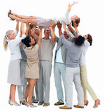 Success-Young woman carried by her colleagues Royalty Free Stock Image