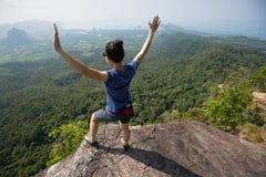 Woman rock climber on mountain peak. Success young woman rock climber on mountain peak Stock Photos