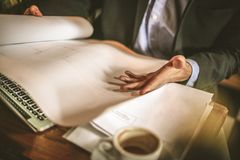 Successes mean hard work. Young business man. Close up. Successes mean hard work. Young business man. Close up image of businessman hand with papers Stock Photo