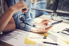 Successful Account Managers Team Analyze Business Reports Modern Interior Design Loft Office.Coworkers Using. Contemporary Tablet.Sharing Information.Blurred Stock Images