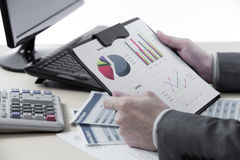 Successful accountant working. With financial data Royalty Free Stock Photo