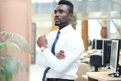 Successful African American businessman businessman standing in office. Successful African American businessman businessman standing in office stock photography