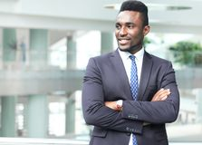 Successful African American businessman businessman standing in office. Successful African American businessman businessman standing in office royalty free stock image