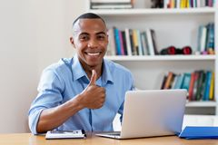 Successful african american man at computer. At home at office royalty free stock photography