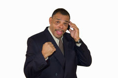 Successful African-American man raising his fist Stock Photo