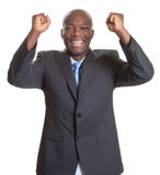 Successful african businessman in a dark suit Stock Images