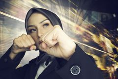 Successful and aggressive young muslimah businesswomen over abstract double exposure background. Creative ideas concept, successful and aggressive young muslimah Stock Photography