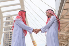 Successful Arabic business people shaking hands Royalty Free Stock Photography