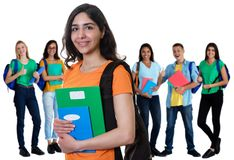 Successful arabic female student with group of students royalty free stock photo