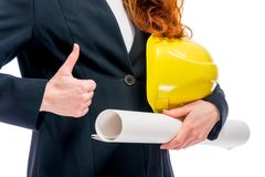 Successful architect conceptual photo - hard hat and blueprints Royalty Free Stock Photo