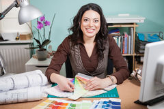 Successful architect woman in her office with color cards in fro. Nt of her. Architecture and construction. Color pallete royalty free stock image