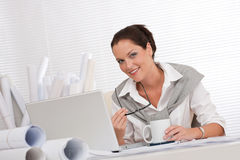 Successful architect woman at office with laptop Royalty Free Stock Images