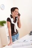 Successful architect woman on phone at office Royalty Free Stock Photography