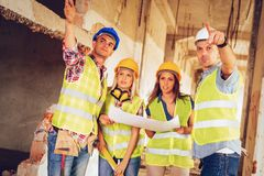 Successful Architects Team. Four construction architects in the building damaged in the disaster. Planing reconstrustion Stock Photos