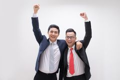Successful Asian business man hands up feeling happy or win with royalty free stock image