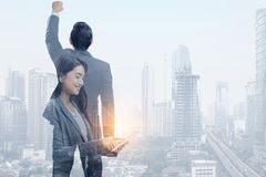 Successful asian business people and modern cityscapes. Double exposure royalty free stock photos