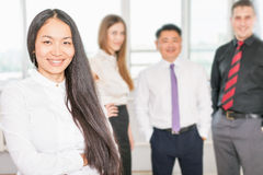 Successful asian business woman with business team Stock Images