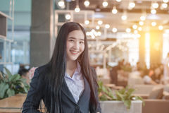 Successful asian business woman with folded hands smiling.  royalty free stock image