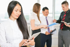 Successful asian business woman holding tablet PC Stock Photos
